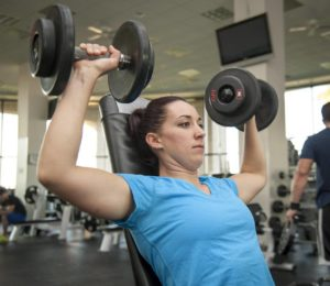 woman training with dumbbells